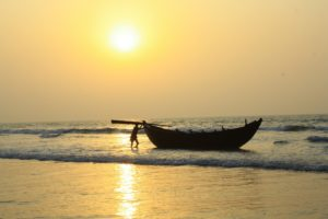 Fisherman and Boat during Sunrise in Sea Beach of Digha, West Bengal, India